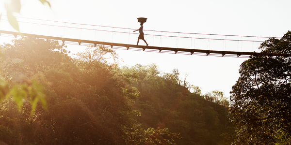 Woman walking across a bridge