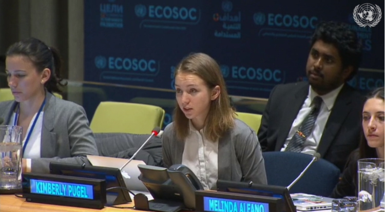Kimberly Pugel sits in front of microphone at UN event