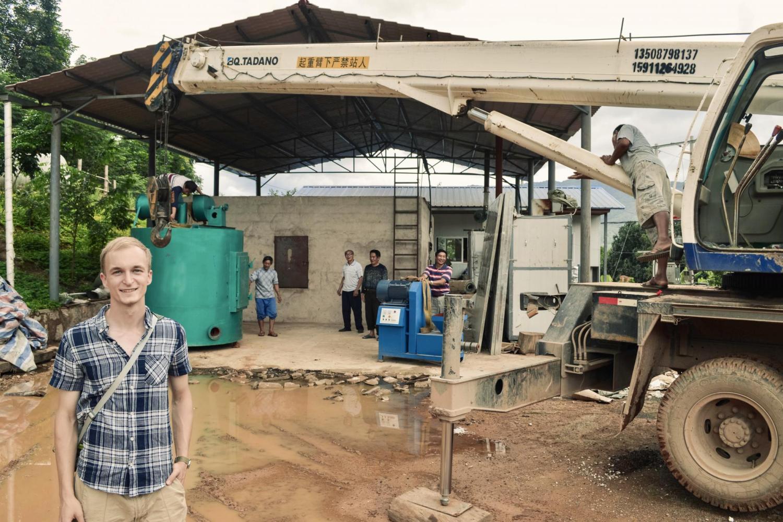 Matthew Bentley standing next to a construction vehicle.