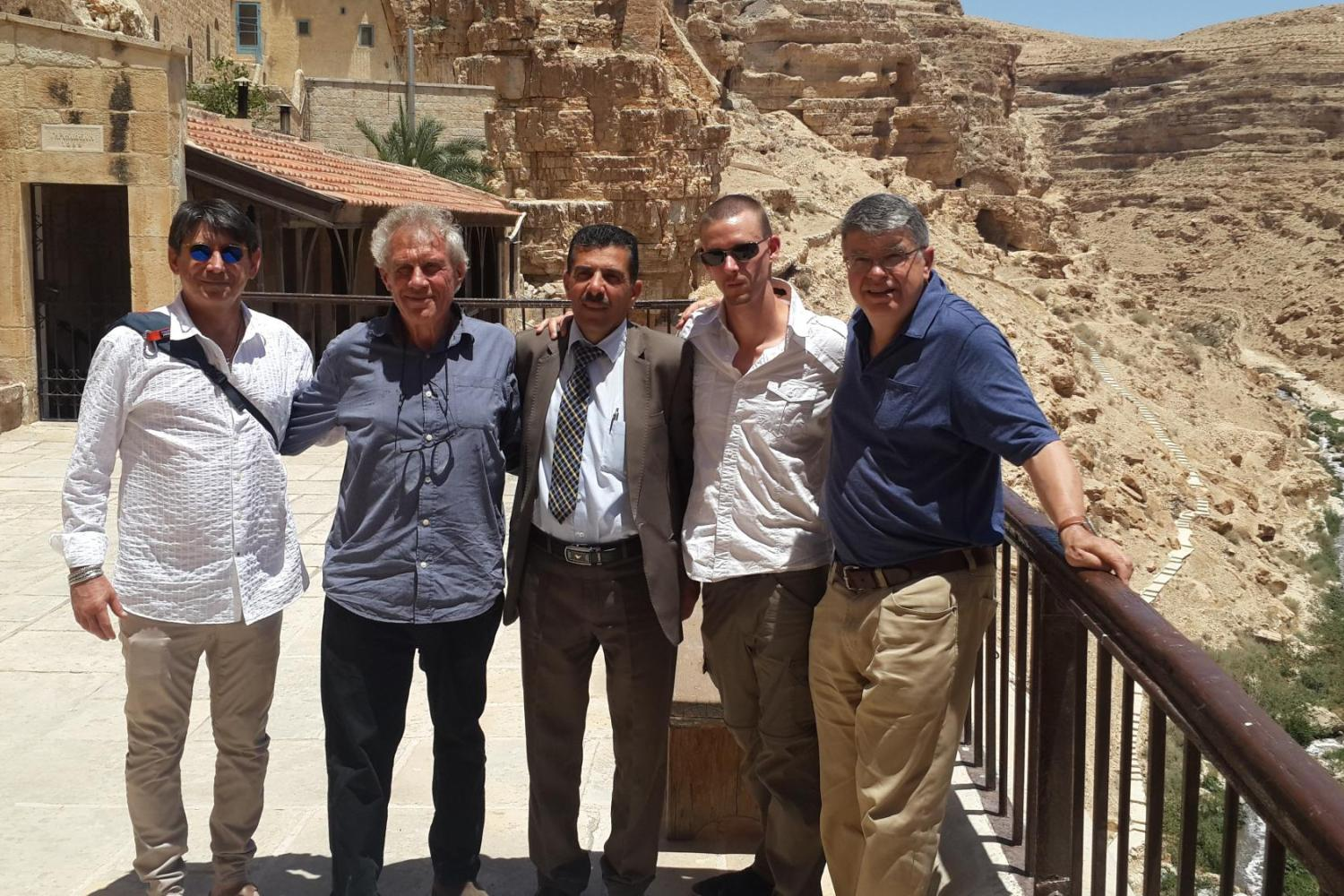 Dave Zelinka and colleagues standing at the St. Saba Monastery.