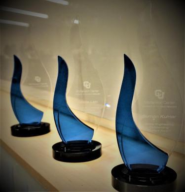Three Awards on a Table