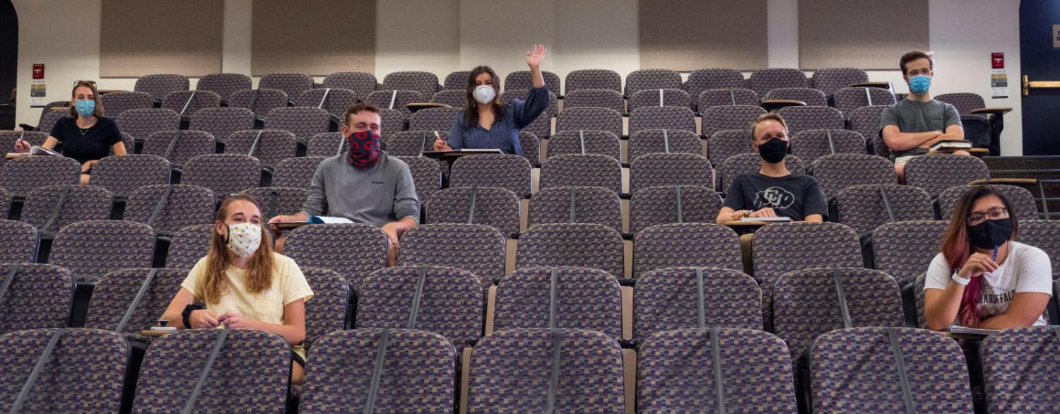 Students sit, distanced and masked, in a CU Boulder classroom