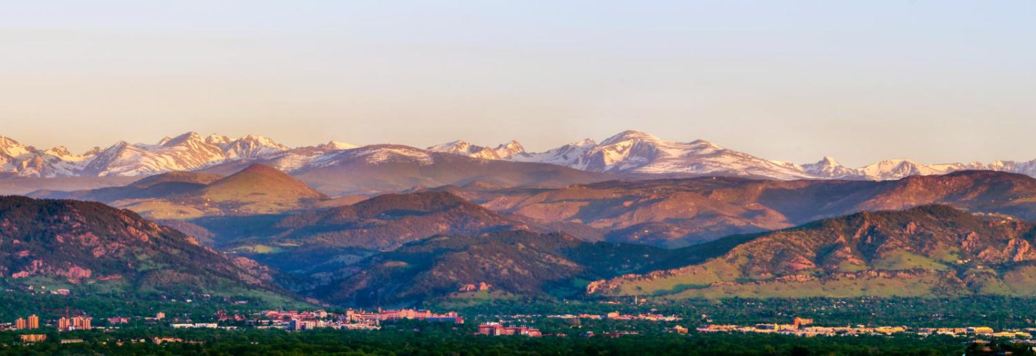 Panoramic photo of campus, foothills, and mountains from Davidson Mesa