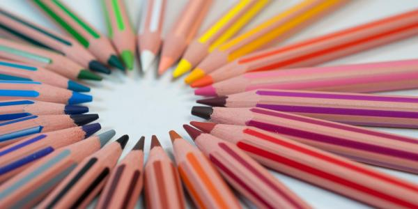 Colored pencils rest in a circle