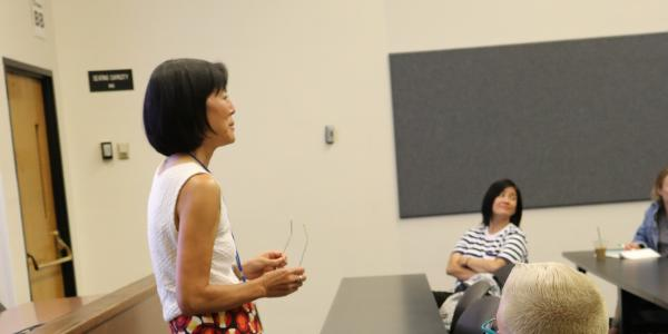 faculty member talking with class