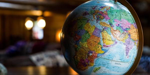 A globe rests on a table
