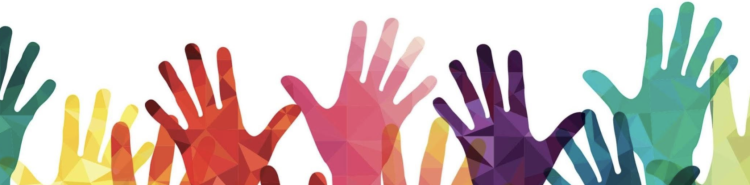 Several hands in multiple colors reach up together