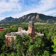 The Old Main building sits in front of the Flatirons