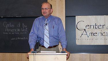 Elliot West standing at a podium in a classrom