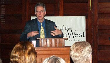 Willett Kempton speaking in front of audience