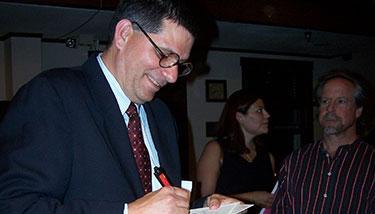 Mark Trahant signing a book