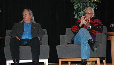 John Echohawk and Billy Frank Jr. sitting on stage