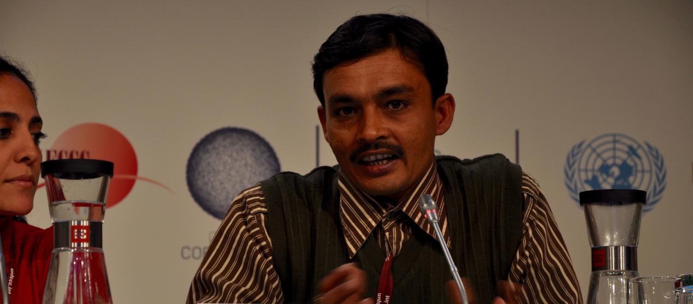 Jaiprakash Choudhry speaks on behalf of waste picker rights at a UN press conference in Copenhagen