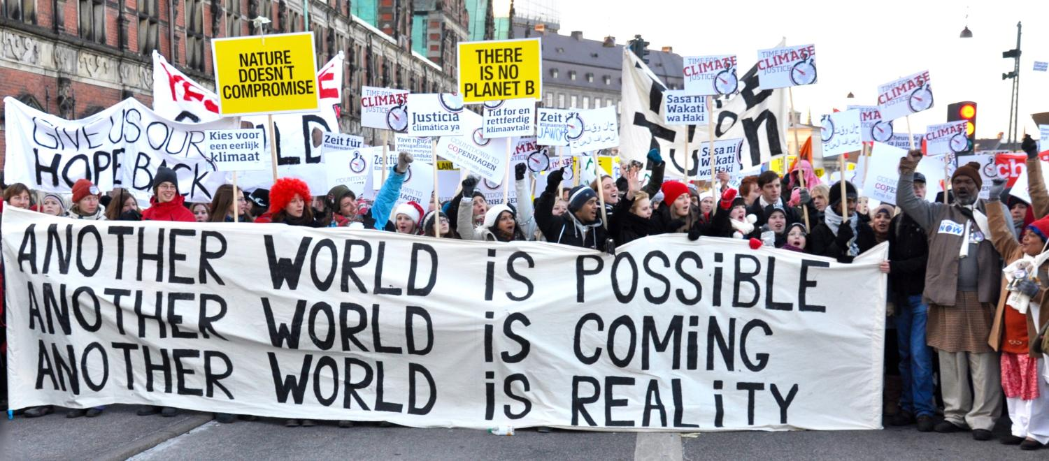 "Marchers at the Copenhagen Climate March hold a banner ""Another world is possible"""