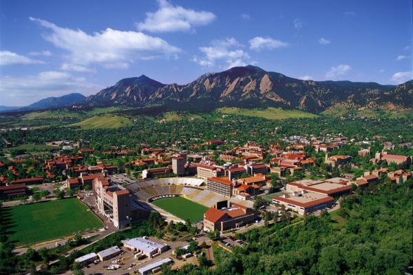 A picture of the University of Colorado, Boulder from above with the Flatirons in the background