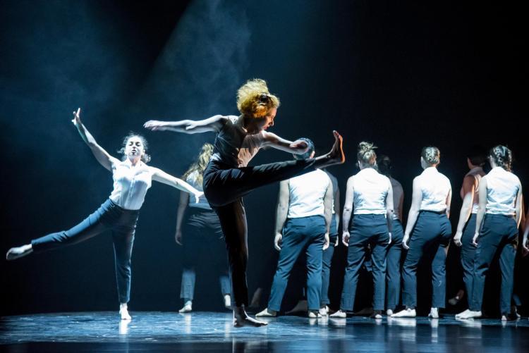 dancer leg in front, dancers behind
