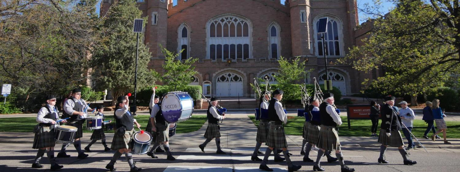 Bagpipes march past Macky Auditorium