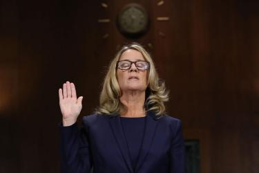Ford testifying left hand up
