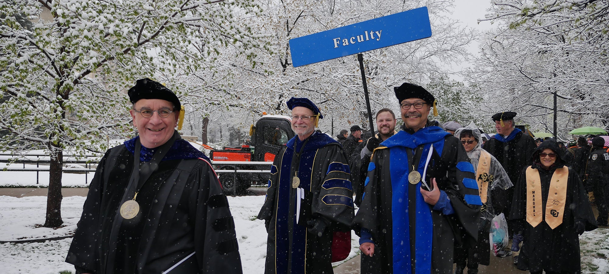 Chancellor and faculty in snowy spring 2019 commencement procession