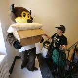 Chip the Buffalo and another volunteer pitch in during move-in week
