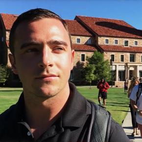 Tanner Scholvin in front of Eaton Humanities