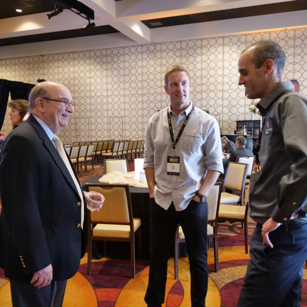 Chancellor DiStefano chats with two CU alumni: Fox Sports football analyst and CU quarterback Joel Klatt, left, and two-time distance running Olympian Alan Culpepper, right, prior to the 2018 CU Boulder Next Los Angeles event.