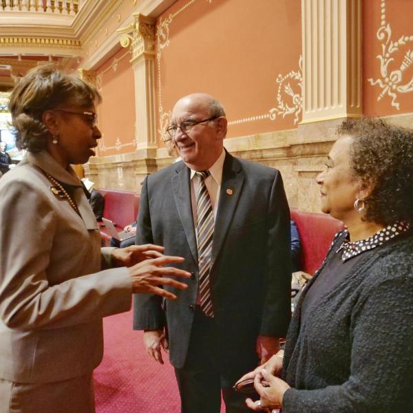 Chancellor Phil DiStefano, center, and professor Polly McLean, right, speak with State Senator Rhonda Fields at the Colorado Capitol in a state tribute to Lucile Berkeley Buchanan, who in 1918 was CU's first African American woman to graduate.