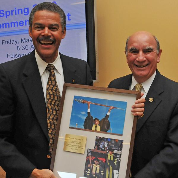 Chancellor DiStefano honors Dean of Libraries James Williams, left, for this 20 years as Commencement Marshal.