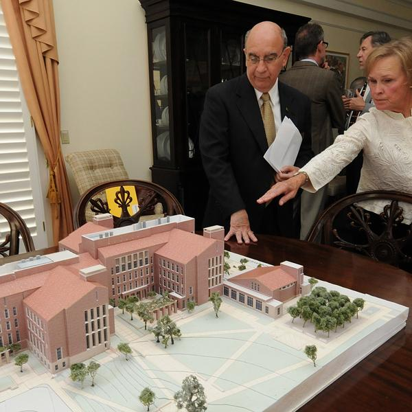 Chancellor DiStefano examines a model of the Jennie Smoly Caruthers Biotechnology Building opening in early 2012.