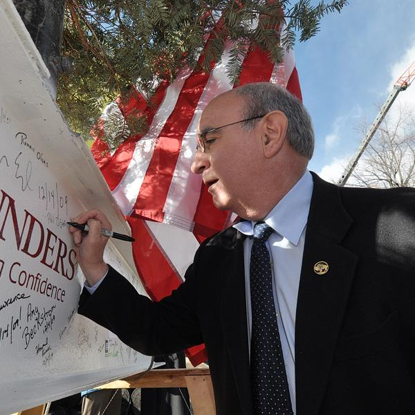 Chancellor DiStefano signs the last beam to top off the Center for Community. It opened in fall 2010.
