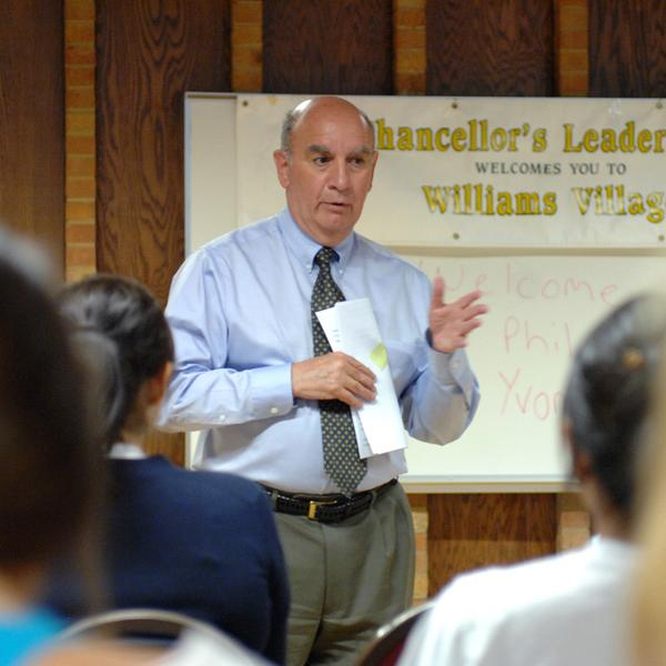 Phil DiStefano talks with students who are part of the Chancellor's Leadership Residential Academic Program.