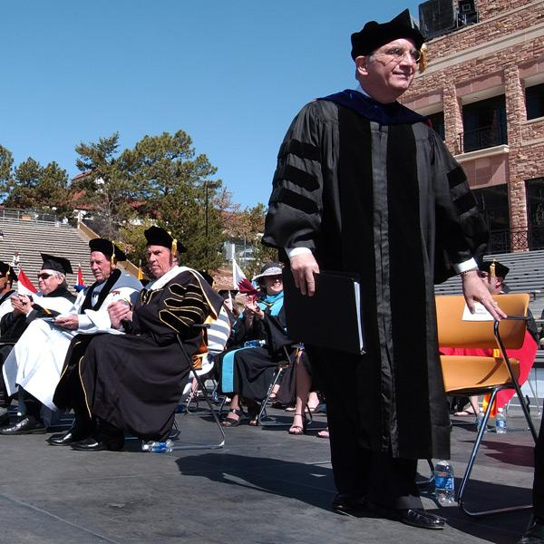 Chancellor DiStefano approaches the podium for his spring commencement address.