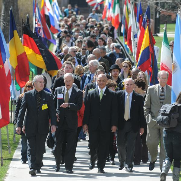 Phil DiStefano and President Bruce Benson lead the annual Conference on World Affairs procession across campus.