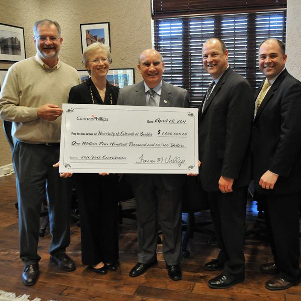 Chancellor Phil DiStefano accepts a donation from Conoco Phillips to fund new energy development.