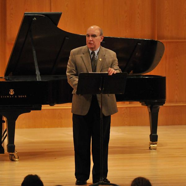 Chancellor DiStefano addresses the audience at the grand re-opening of Grusin Music Hall.