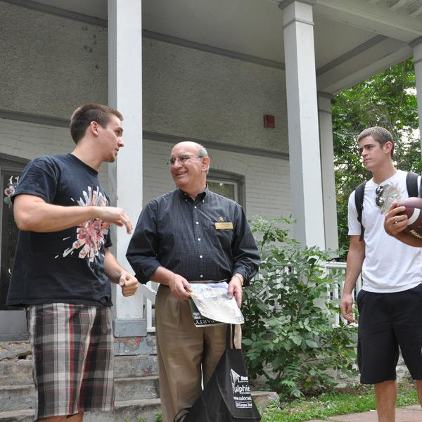 Chancellor DiStefano chats with students living off campus.