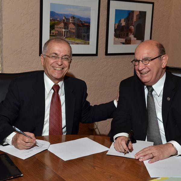 Chancellor Philip P. DiStefano, right, and Jet Propulsion Lab Director Charles Elachi sign a memorandum of understanding to continue and broaden a tradition of collaboration between JPL and CU-Boulder.