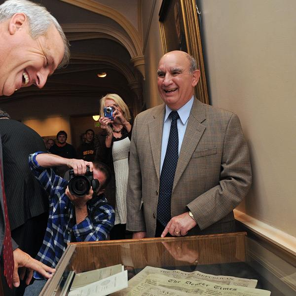 Former Gov. Bill Ritter, left, and Chancellor Phil DiStefano examine the 100-year time capsule at Macky Auditorium.