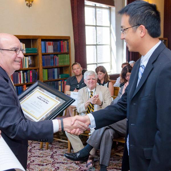 Computer scientist Tom Yeh is awarded the 2014 Student Affairs Faculty Member of the Year Award by Chancellor Philip DiStefano for outstanding engagement with students.