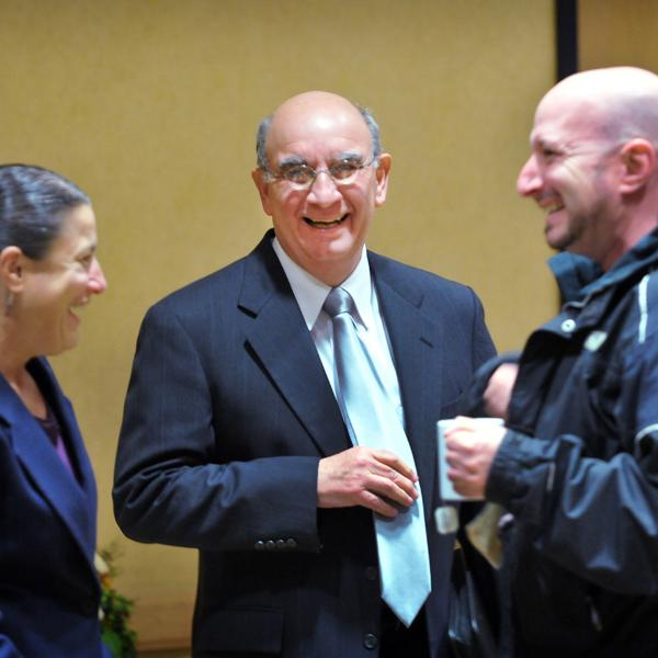 Phil DiStefano, center, shares a laugh with education professor Valerie Otero and physics professor Noah Finkelstein.