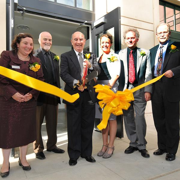 Chancellor DiStefano and dignitaries cut the ribbon at the new state-of-the-art Visual Arts Complex in September 2010.