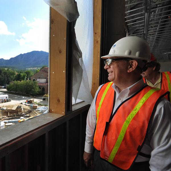 Chancellor DiStefano admires the view from the now-completed Visual Arts Complex during construction.