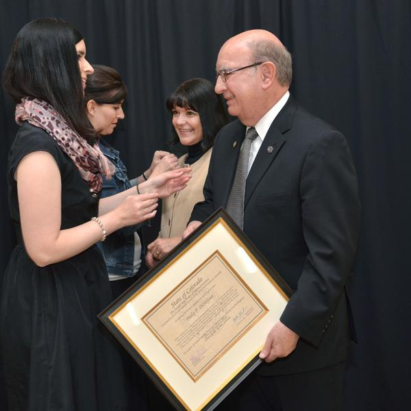 Chancellor DiStefano's daughters, Jennifer and Nicole, pin 40 Years of Service