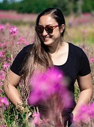 Mia Keyser in a field of flowers