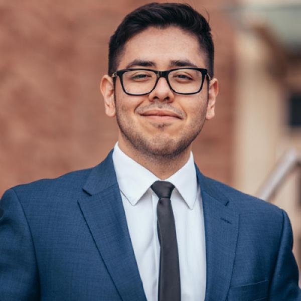 Marvin Gonzalez in blue suit
