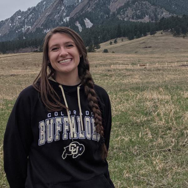 Jenna Trost in Buffs sweater in front of mountains