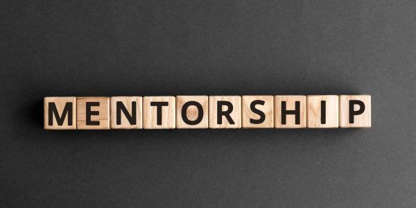 Wooden blocks spelling the word mentorship