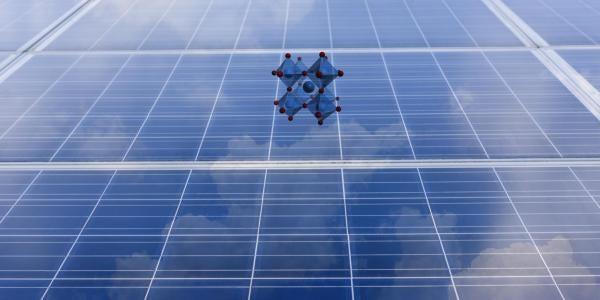 A perovskite molecule floating over a solar panel