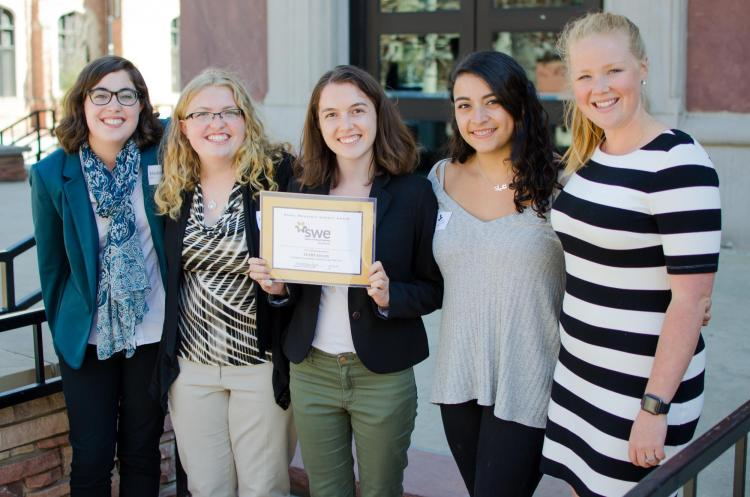 Society of Women Engineer members with a certificate.