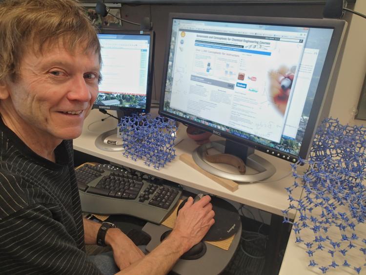 Professor John Falconer working on the learncheme.com website.